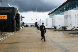 Tom Wilkinson strides around the F1 paddock.