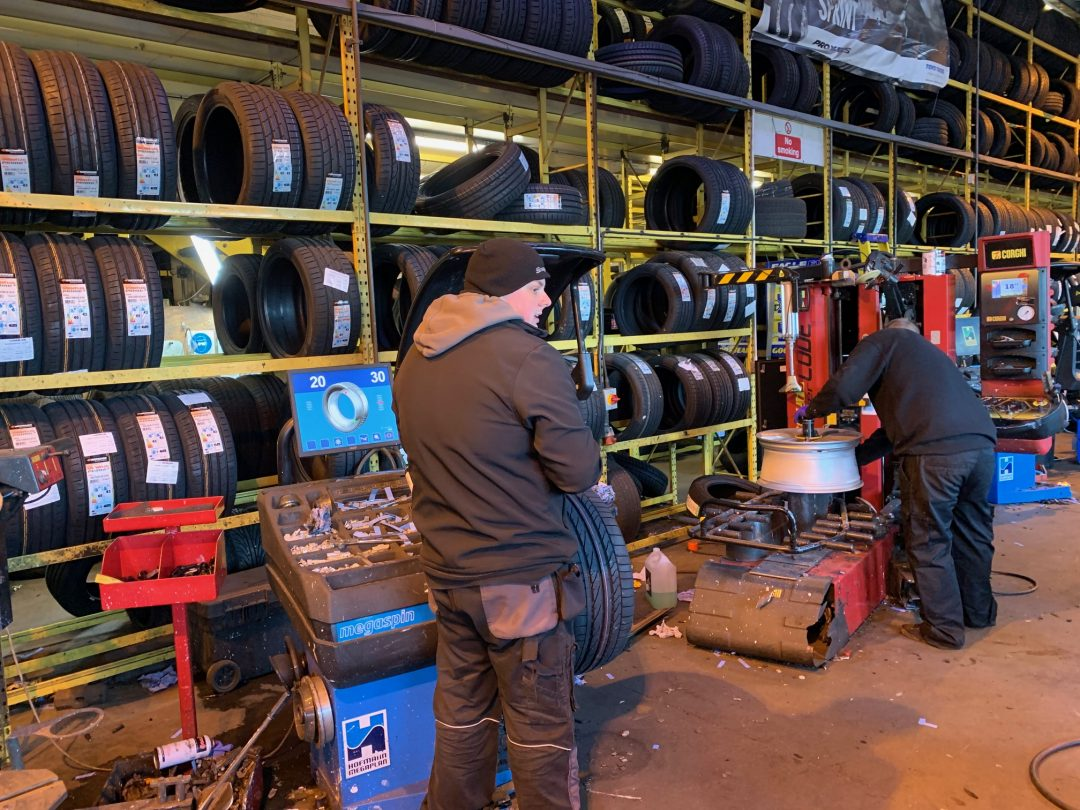 A new set of Bridgestone Potenza run flats being fitted to the M Sport rims.